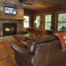 Nantahala River Lodge spacious living room with comfortable leather furniture and a wood burning fireplace